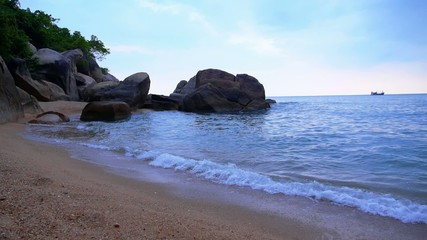 Rocks, Stones, Blue Sea, Foamy Waves on the Beautiful Beach of