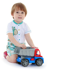 kid boy toddler playing with toy car