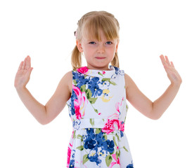 Cute little girl throws a side arm.