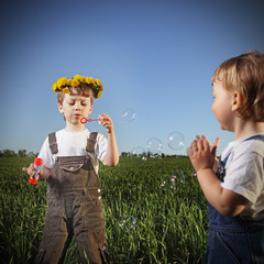 two boys play in bubbles