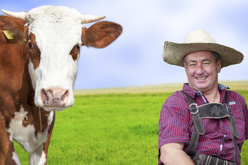Portrait of farmer with his cow