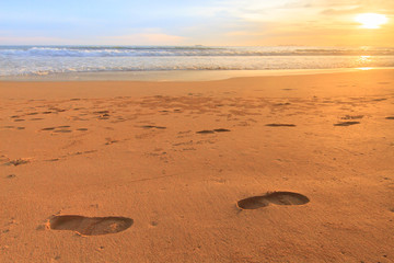 Foot print on the sunset beach