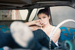 Sensual woman smoking in abandoned car.