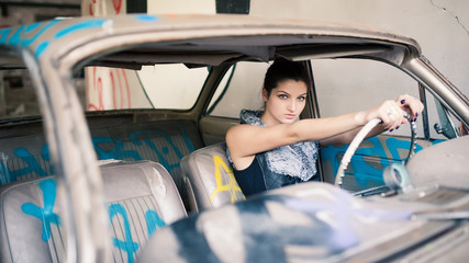 Sensual woman portrait in abandoned car.