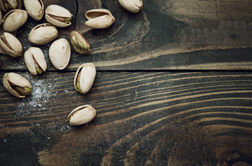 Closeup of pistachios nuts on wooden table