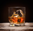 Glasses of whiskey with ice cubes