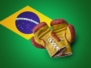 Red and Yellow boxe gloves on Brazil flag
