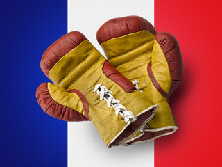 Red and Yellow boxe gloves on French flag