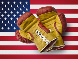 Red and Yellow boxe gloves on USA flag