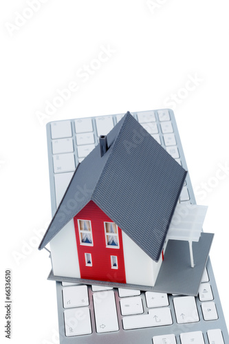Wohnhaus auf Tastatur