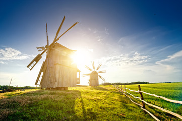 A traditional windmill on the countryside at sunset
