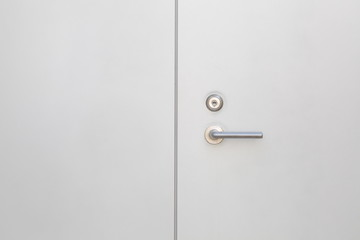White modern metal door and metal handle
