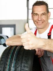 Master mechanic in a garage shows ok