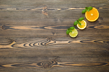 Mix citrus fresh fruit on the wooden table