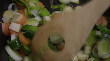 Preparing the vegetables in a pan