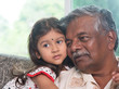 Grandparent and grandchild close up face