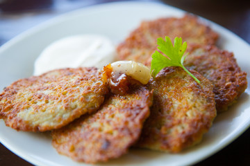 "Potato pancake ""dranik"" with sauce, traditional Ukrainian dish"