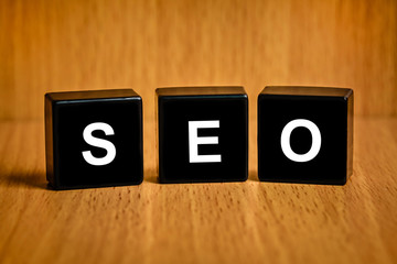SEO or Search engine optimization word on black block