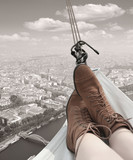 Woman in a hammock over Paris. - 66342772