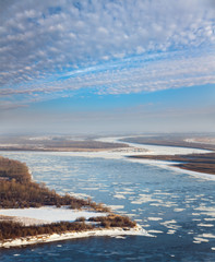 Great river with floating ice floes,top view