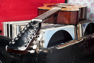 Guitar on a trunk full of old vinyl records