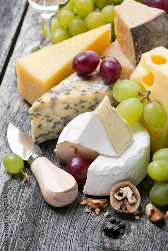 assortment of fresh cheeses, grapes and walnuts - 66342754