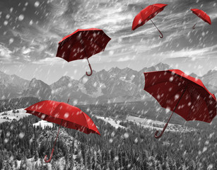 flying red umbrellas in the mountains during a storm