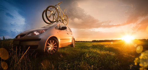 Two bicycle on the roof of the car