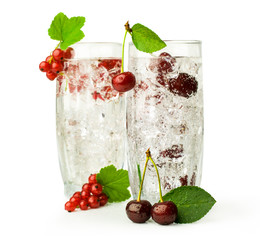 two cocktails with currants and cherries
