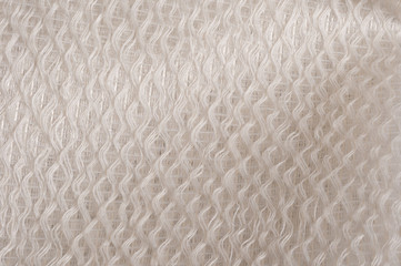 white glossy quilted cloth
