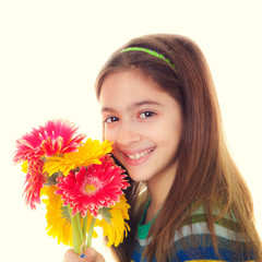 smiling child with bunch of daisies.