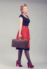 woman with a suitcase in a retro style.