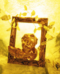 Cherub figurine in picture frame