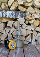 Lamps are on a background of firewood