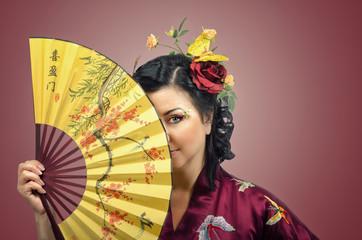 Kimono white woman hiding her face behind Asian fan