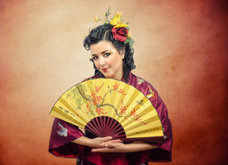 Portrait of kimono white mature woman with fan