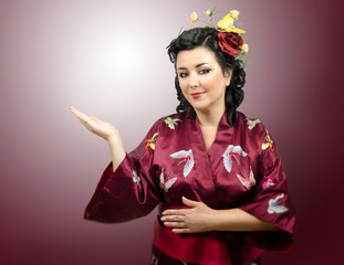 Portrait of kimono woman raised her right hand