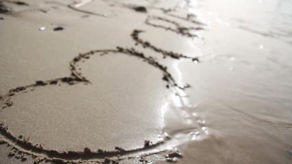 inscription on the sand - I love crete