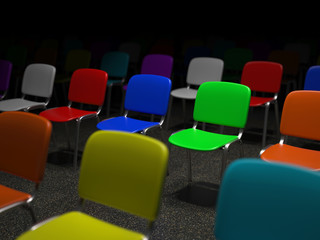 Many colorful chairs standing in a grid