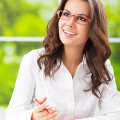 Young smiling businesswoman working at office