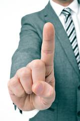 businessman holding up his index finger