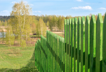 Long wooden fence of green planks