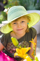 girl with hat and flower