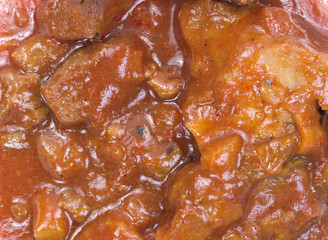 Close view braised beef in red chili sauce