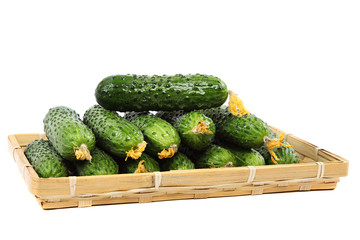 Fresh cucumbers in wooden basket.