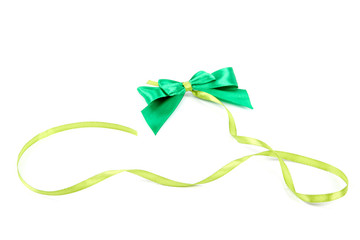 Green bow and ribbon on a white background.