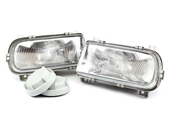 Car headlights isolated on a white background.