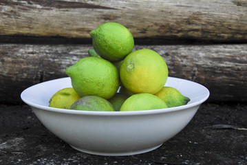 green lemons in a bowl