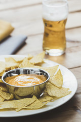 Nacho Chips with cheese and Beer
