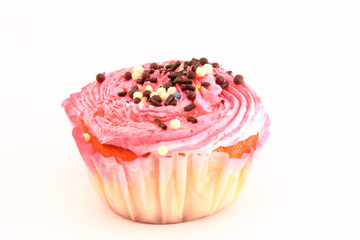 Pink and creamy cupcake decorated with chocolate pearls.